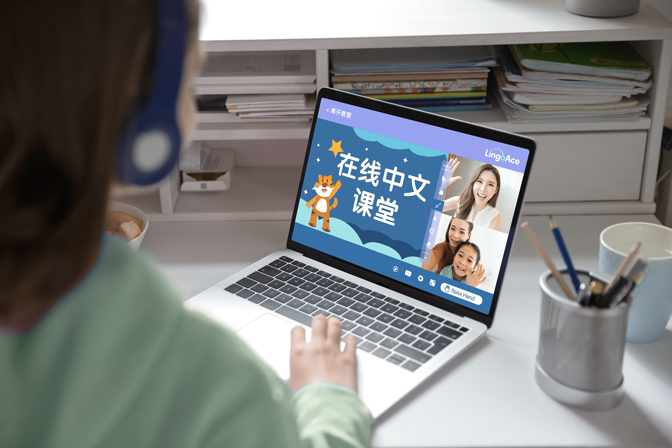 A girl interacting with her teacher in an online Chinese class