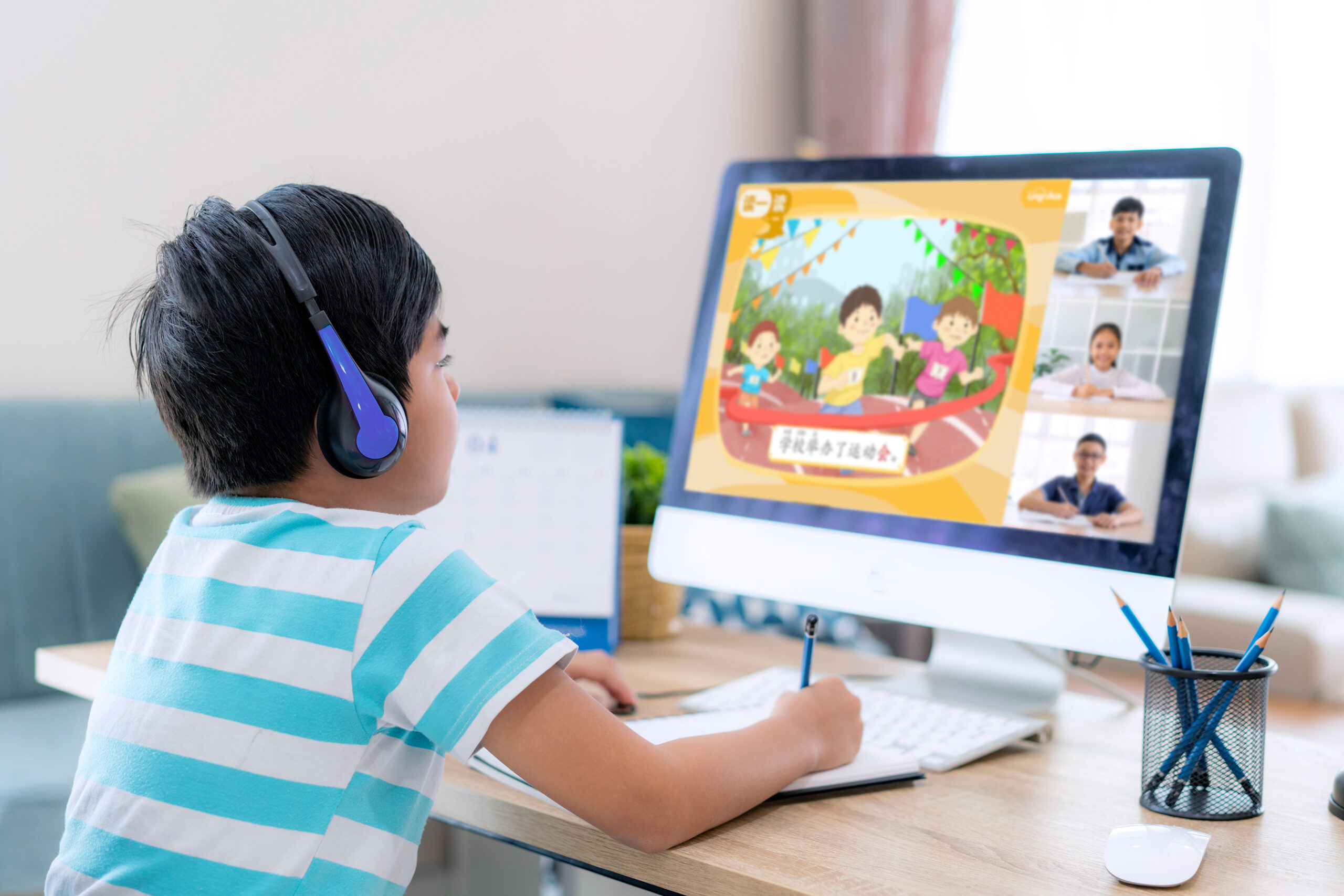 A boy concentrates on his 1-to-4 online Chinese class