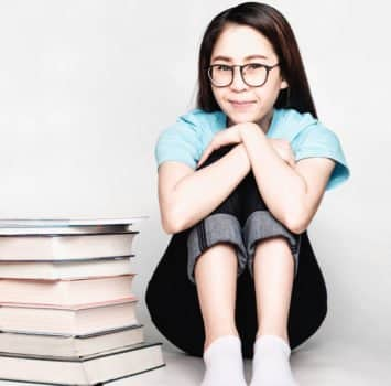 Beautiful asian female students during the exam Stay home and stressful and lazy reading books