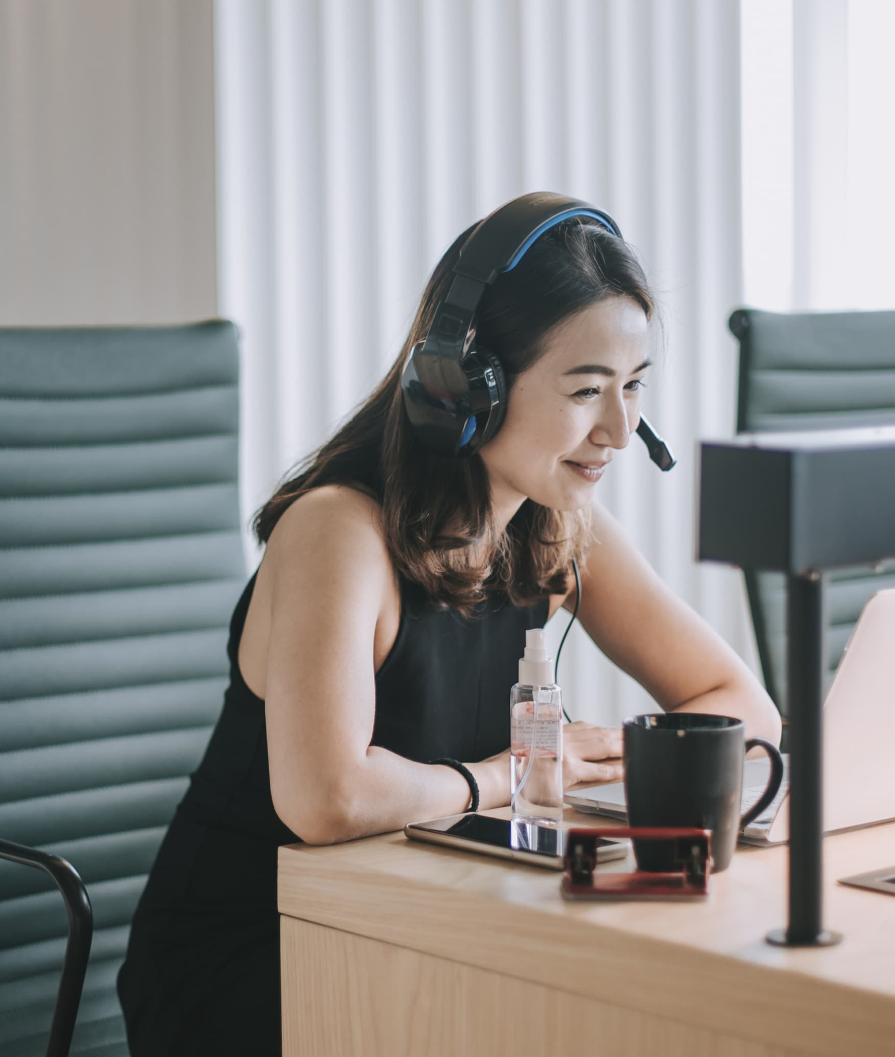 an asian chinese beautiful woman white collar worker talking to the camera video calling video conference with his business partners  with face mask